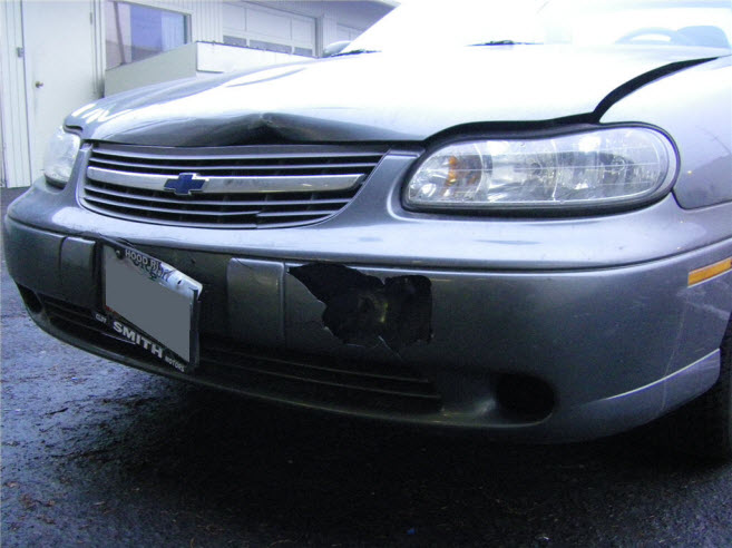 Chevy Malibu bumper and hood repair.